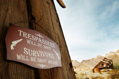 Old west. Close up view of old style wild west no trespass sign on theу wall stock photo