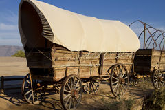 Old West Covered Wagon Train. Historic old Western covered wagons form a wagon train Stock Photography