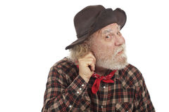 Old West cowboy pulls on ear and thinks of idea Stock Photo