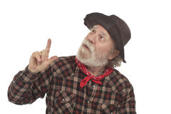 Old west cowboy with whiskers points up Royalty Free Stock Photography