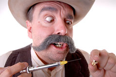 Old West Dentist. Old west cowboy with mustache giving a dental injection Royalty Free Stock Image