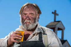 Old West Drunkard Drinks Royalty Free Stock Photos