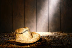 Old West Farmer Hat on Rope in Vintage Ranch Barn Royalty Free Stock Photos