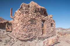 Old West Mining Shack. In the California Desert under a bright blue sky Royalty Free Stock Photography