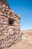 Old West Mining Shack. In the California Desert under a bright blue sky Stock Images