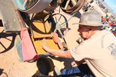 Old West: Modern Gold Prospector at Antique Stamp Mill Stock Image
