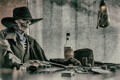 Old West Poker Playing Skeleton Gun Stock Photos