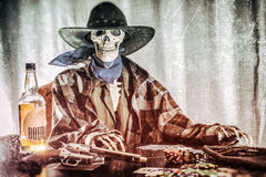 Old West Poker Skeleton Bourbon Gun Stock Photos