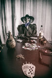 Old West Poker Skeleton Dead Mans Hand. Old west bandit outlaw skeleton at a poker table with a pistol and bourbon, cards showing aces and eights (dead man's stock photography