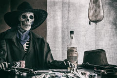 Old West Poker Skeleton Outlaw Stock Photography