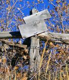 Old West Post sign. A weathered old post with a broken missing sign Stock Images