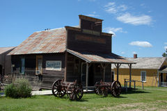Old West Store. An old west store with wagon wheels in front stock images