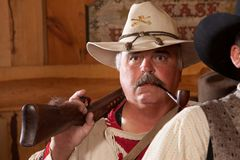 Old west trapper with pipe Stock Photos