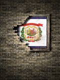 Old West Virginia flag in brick wall. 3d rendering of a West Virginia State flag over a rusty metallic plate embedded on an old brick wall royalty free illustration