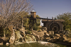 Old West Waterworks. This is a picture of old west waterworks, aqueduct, water wheel, and water tank outside of Tucson, Arizona Stock Photo