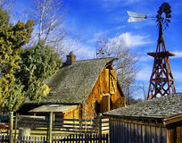 Old Western Barn. And windmill Stock Photo