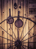 Old western cabin with wagon wheel Stock Image