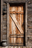 Old western door with lantern in front Stock Photos