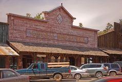 Old Western General Merchandise Store. This photo shows an old Western type general merchandise store of olden days, with modern customers Stock Photo