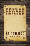 Old western reward sign. Old western wanted sign on wooden wall Royalty Free Stock Photo