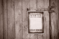 Old western sign, on wooden background. Royalty Free Stock Photos
