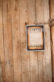 Old western sign, on wooden background. stock photo