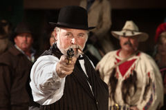 Old Western Smoking Man with Gun Royalty Free Stock Image