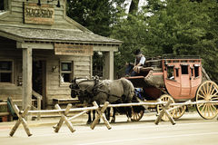 Old western stagecoach. An old, western stagecoach stopped in front of a stage coach building, Jackson Hole, Wyoming stock photography