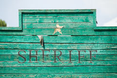 Old, western style green wooden Sheriff sign Royalty Free Stock Images