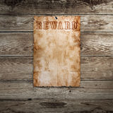 Old western wanted poster. On wooden background stock image