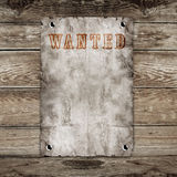 Old western wanted poster. On wooden background royalty free stock photos