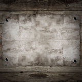 Old western wanted poster. On wooden background Royalty Free Stock Image