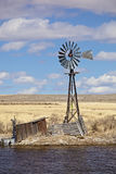 Old Western wind mill Stock Images