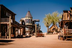 Old Western Wooden Buildings in Goldfield Gold Mine Ghost Town in Youngsberg, Arizona, USA. Surrounded by cactuses stock images