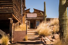 Old Western Wooden Buildings in Goldfield Gold Mine Ghost Town in Youngsberg, Arizona, USA. Surrounded by cactuses royalty free stock photography