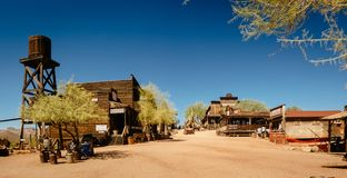 Old Western Wooden Buildings in Goldfield Gold Mine Ghost Town in Youngsberg, Arizona, USA. Surrounded by cactuses royalty free stock image