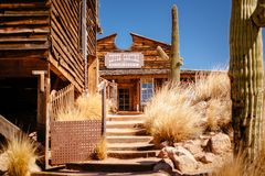 Old Western Wooden Buildings in Goldfield Gold Mine Ghost Town in Youngsberg, Arizona, USA. Surrounded by cactuses stock photography