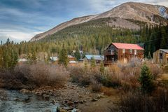 Old Western Wooden Buildings in St. Elmo Gold Mine Ghost Town in Colorado, USA. Hidden in mountains royalty free stock photos