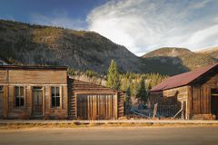 Old Western Wooden Buildings in St. Elmo Gold Mine Ghost Town in Colorado, USA. Hidden in mountains stock image