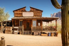 Old Western Wooden Bulding in Goldfield Gold Mine Ghost Town in Youngsberg, Arizona, USA. Surrounded by cactuses royalty free stock photos