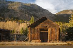 Old Western Wooden garage in St. Elmo Gold Mine Ghost Town in Colorado, USA. Hidden in mountains stock photography