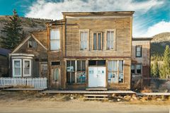 Old Western Wooden post office or saloon in St. Elmo Gold Mine Ghost Town in Colorado, USA. Hidden in mountains royalty free stock image