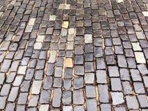 Old wet granite cobblestone street in the rain Royalty Free Stock Photos