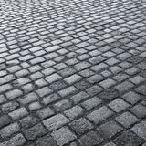 Old wet stone paved avenue street road Stock Photography