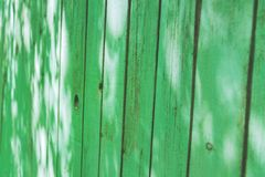 Old wethered green wooden fence background texture, Perspective royalty free stock photography