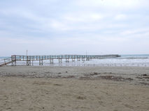Old wharf. End of winter season in Rimini, Italy - beach without people Royalty Free Stock Photography
