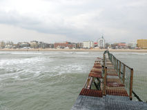 Old wharf. End of winter season in Rimini, Italy - beach without people Stock Images