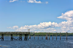 Old wharf with pilings Stock Photo