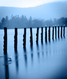 Old wharf posts - artistic Stock Images