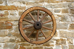 Old wheel. On the wall stock images